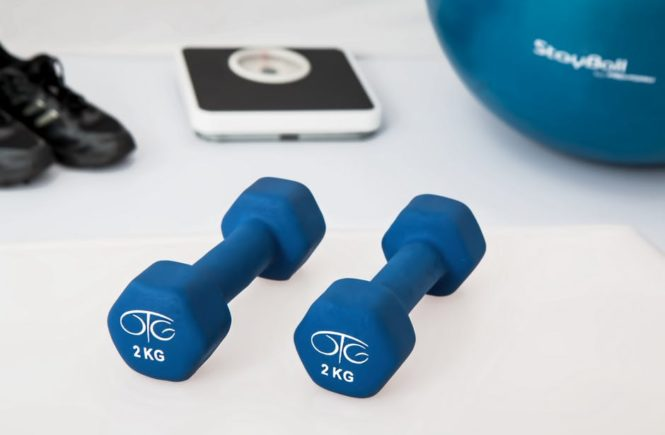 Essential Guide To The Perfect Home Workout weights on ground