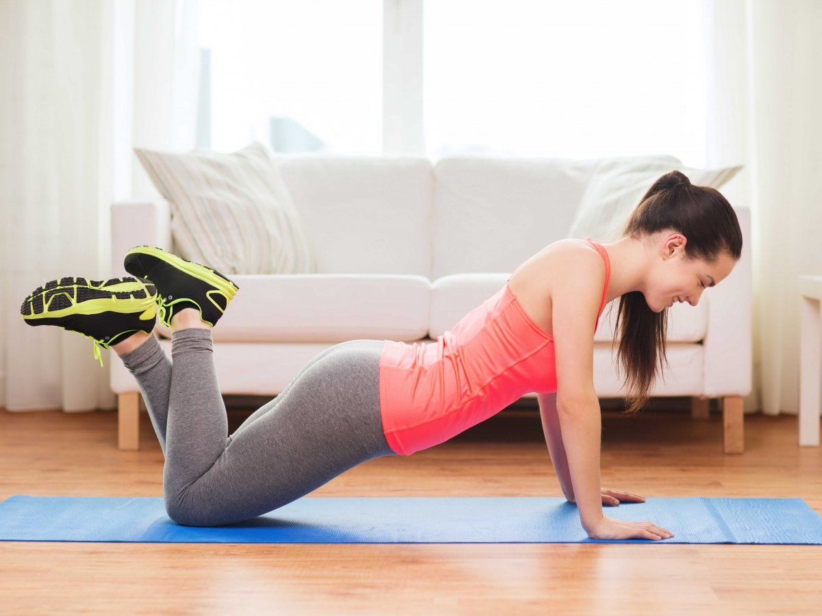 Best Workouts You Can Do Without Going To The Gym woman stretching