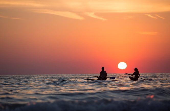 6 Unexpected Fitness Benefits Of Paddle Boarding