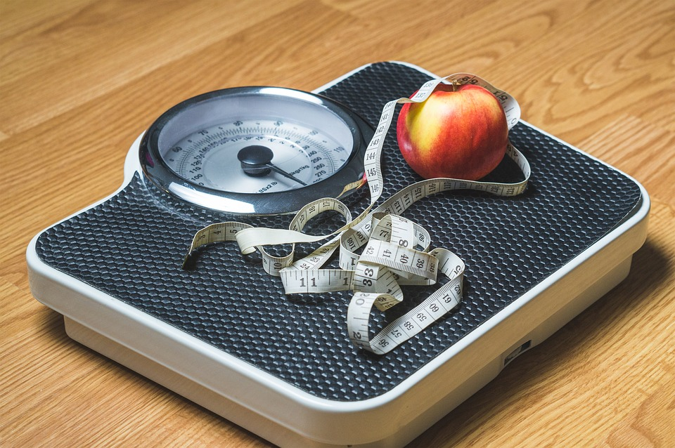Reasons Why You Aren't Losing Weight apple on scale